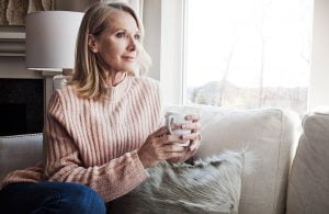 woman enjoys coffee at home after facelift