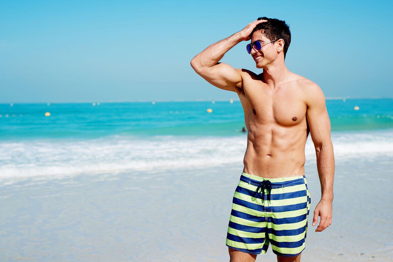 Man Enjoys the Beach After CoolSculpting Treatments Summer 2021