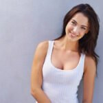 Woman Enjoys IDEAL Implants both safe and natural looking from plastic surgeron Dr. Claytor in Bryn Mawr